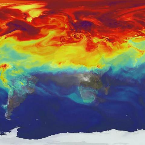 Flat map of the world showing concentration of carbon dioxide in the atmosphere, indicating especially hot spots in the Arctic and northern regions.