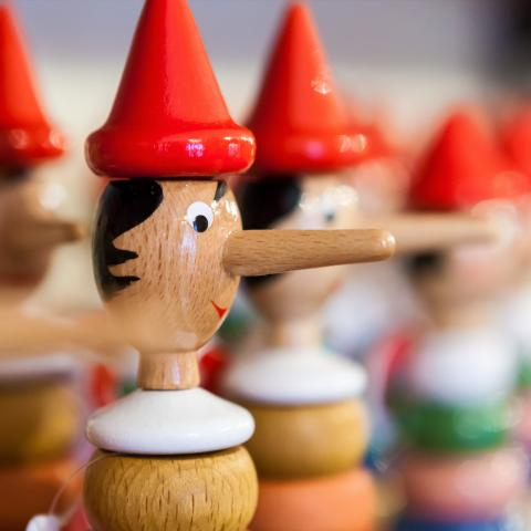 A row of wooden Pinocchio toys