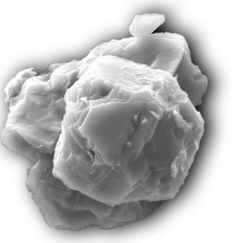 black and white image, close-up of crystalline dust fragment